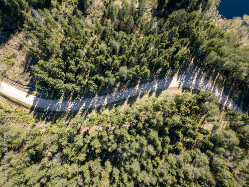 drone image. aerial view of rural area with fields and forests and gravel roads seen from above