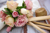 Close-up of beautiful bouquet of rose flowers on wooden table - 204145544