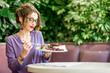 Woman with healthy food at the restaurant