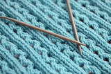 Blue knitted sweater  with knitting needles closeup - 204145968