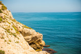 high cliff above the sea, summer sea background, many splashing waves and stone - 204146935