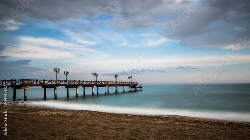 Beach in Marbella at Sunset on a cloudy day
