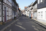 Tiny street with old nordic style houses in the town of Goslar, Germany in the Harz region.