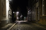 Tiny street with old nordic style houses at night in the town of Goslar, Germany in the Harz region.