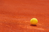 Tennis ball on clay court - 204197358