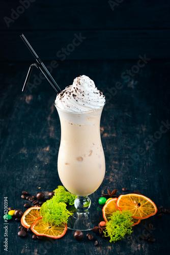 Plexiglas Milkshake Milk shake. On a black wooden background. Copy space.