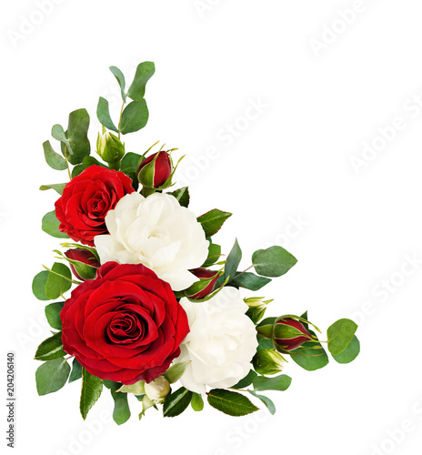 Red and white rose flowers with eucalyptus leaves in a corner arrangement