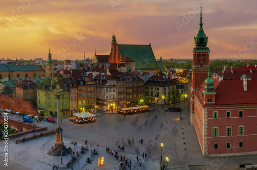 Fototapeta Warsaw, Royal castle and old town at sunset