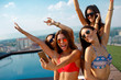 Quadro Four young women in a penthouse near the pool doing selfie in a bikini