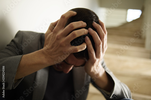 desperate man with his hands in his head