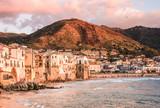 Cefalu panoramic view of harbor at sunset, Palermo, Sicily.