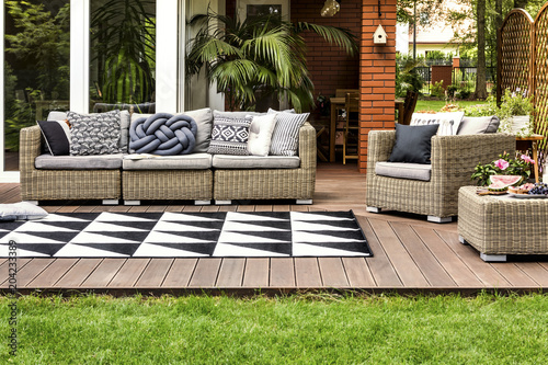 Rattan sofa on terrace - 204233389