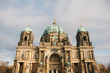 The Berlin Cathedral is called Berliner Dom. Beautiful old building in the style of neoclassicism and baroque with cross and sculptures.