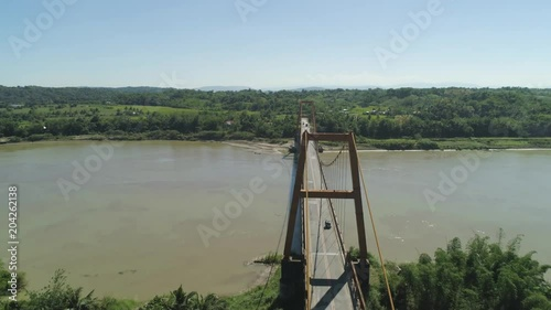 Fridge magnet Aerial view of modern bridge with cars over tropical river in mountain province Philippines,Luzon.