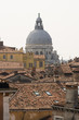 Panoramic view on the roofs of Venice with the church Santa Maria della Salute in the background, Italian landscape.