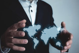 Man holding illustration world map. International business concept