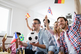 Fototapety Excited fans of soccer celebrating winning match