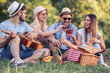 Happy young people enjoying picnic party