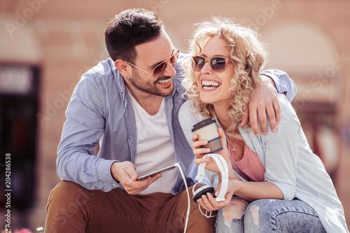 Fotobehang Muziek Beautiful couple listening to music outdoors