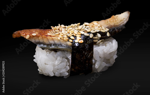 Plexiglas Sushi bar One Eel Sushi on a black background