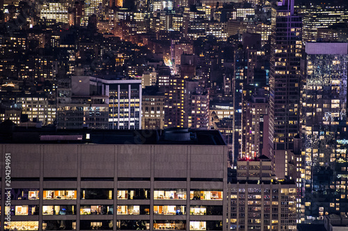 Plexiglas New York 'Selective focus' Aerial view of Manhattan skyline illuminated at night. New York, USA.