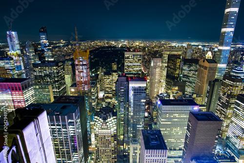 Fotobehang New York Aerial view of Manhattan skyline illuminated at night. New York, USA.