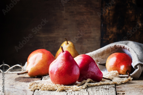 Foto Murales Pears, old wooden background, selective focus
