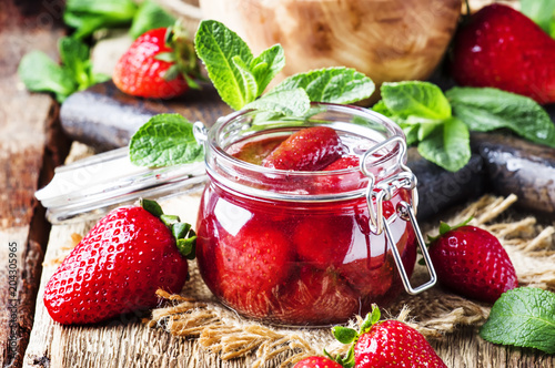 Strawberry jam, vintage wood background, selective focus © 5ph