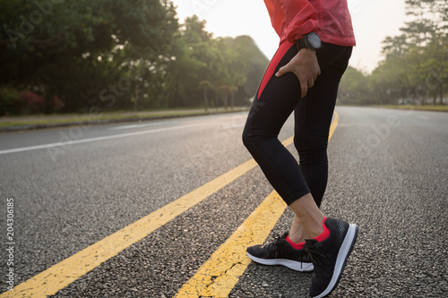 Woman runner with injured leg