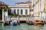 Beautiful building in Venice with boat and pier in the foreground