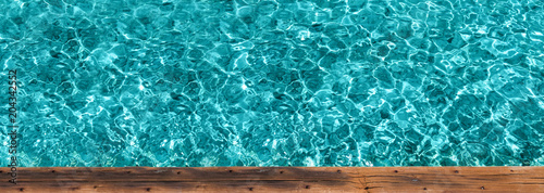 Wooden pier with crystal water