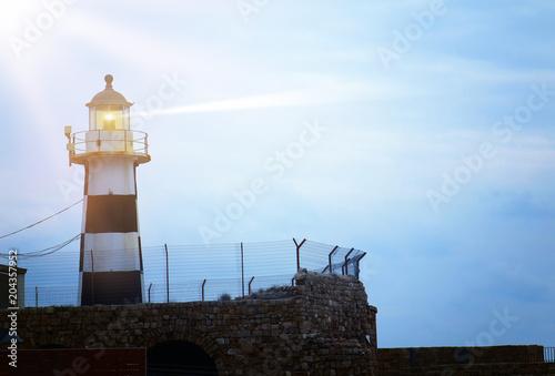 Fotobehang Vuurtoren image of old Lighthouse in the twilight.