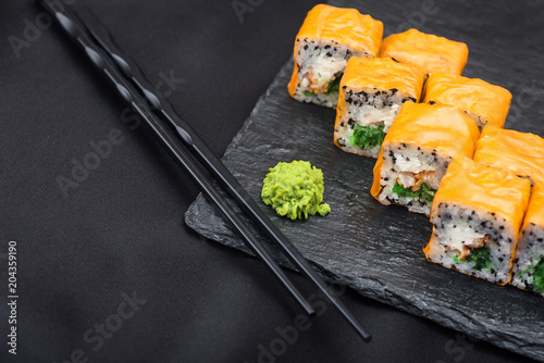 Fotobehang Sushi bar Fresh sushi on a black slate