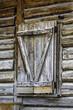 shuttered Log cabin window