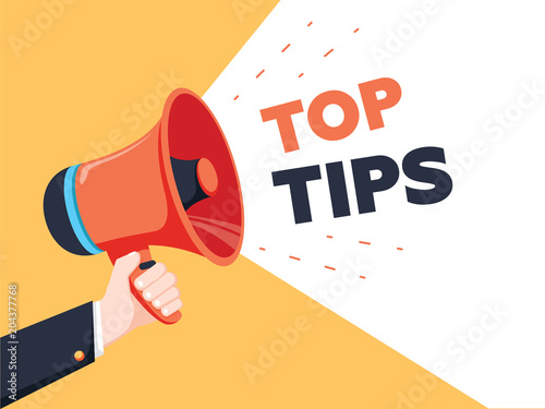 Male hand holding megaphone with Top Tips speech bubble. Loudspeaker. Banner for business, marketing and advertising.
