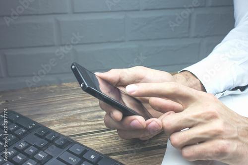 Business image - a businessman using a smartphone