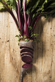 raw beetroot on a rustic wooden table