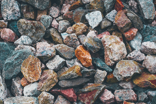Plexiglas Stenen Stones texture background. Red blue grey orange yellow rocks