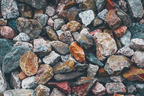 Canvas Stenen Stones texture background. Red blue grey orange yellow rocks