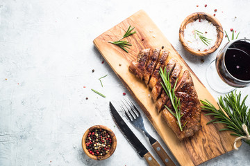 Grilled beef striploin steak with red wine.