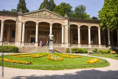 Leinwanddruck Bild Baden-Baden, Germany. The Trinkhalle (Pump House), a building in the Kurhaus spa complex, with a 90-metre arcade colonnade lined with frescos and benches