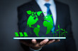 Businessman with a green globe. eco-friendly business. Business and environmental concepts.