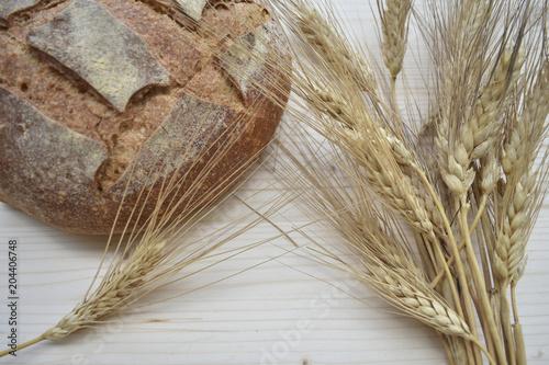 Fototapeta Fresh Bread On Wooden Background