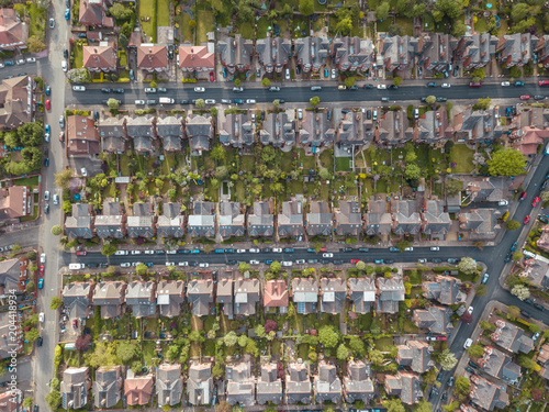 Residential houses drone above aerial view blue sky with park and greenery