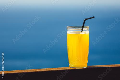 orange juice against blue sea background