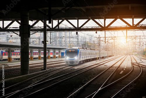 Korea train on railway with skyline at Seoul, South Korea for transportation background