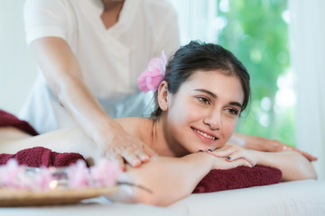 Yougn Asian woman relaxing with hand spa massage at beauty spa salon..