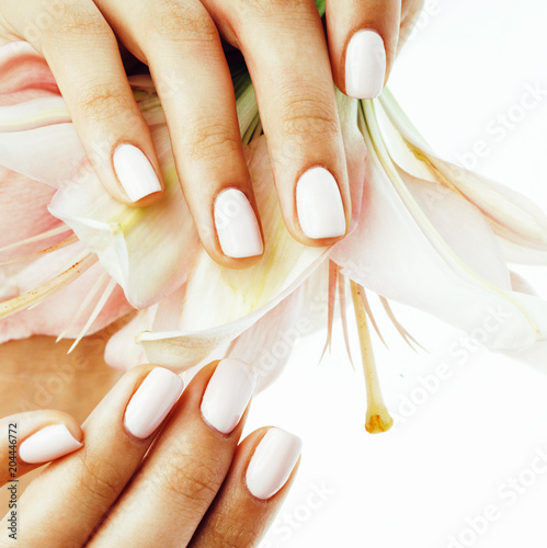 beauty delicate hands with manicure holding flower lily close up - 204446772