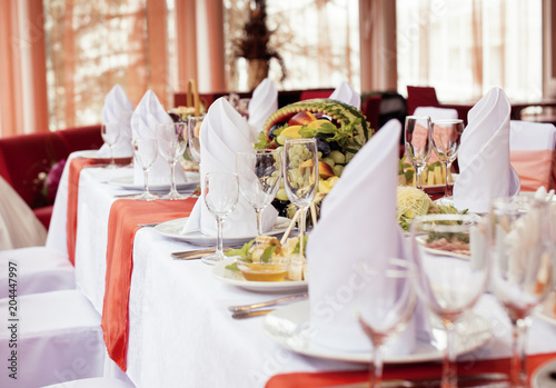 wedding tables in restairant, nobody at begining, red interior - 204447997