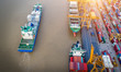 Leinwanddruck Bild Container ship in import export and business logistics, By crane, Trade Port, Shipping cargo to harbor, Aerial view from drone, International transportation, Business logistics concept
